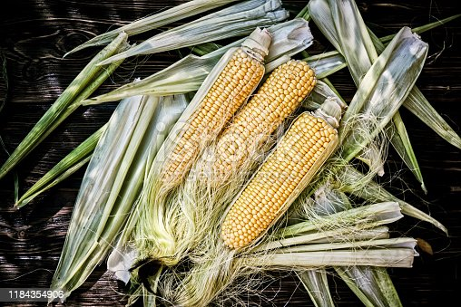 Fresh corn ears On Wooden Table