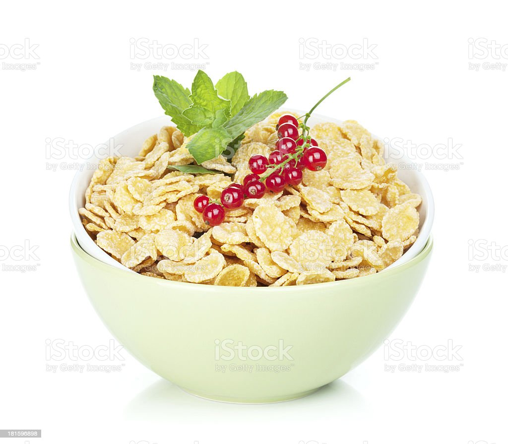 Fresh corn flakes with red currant royalty-free stock photo