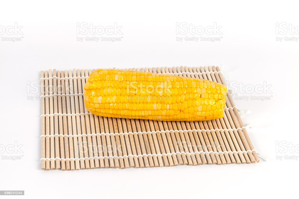 fresh corn on white and wooden background royalty-free stock photo