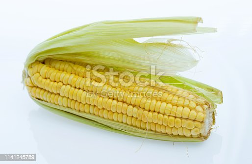 Fresh corn on white background.