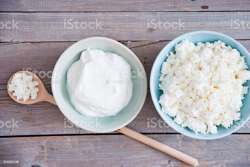 Fresh cottage cheese and Sour cream stock photo