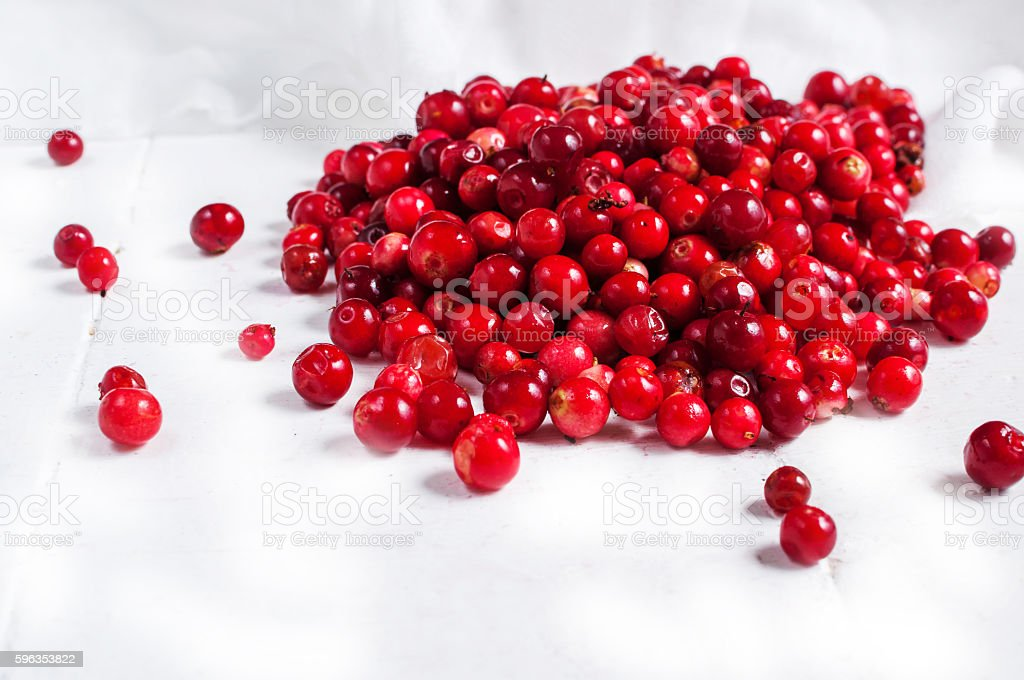 fresh cowberry on wooden background, selective focus royalty-free stock photo