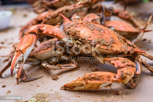 Outdoor shot of peeling fresh Crabs from Maryland, USA