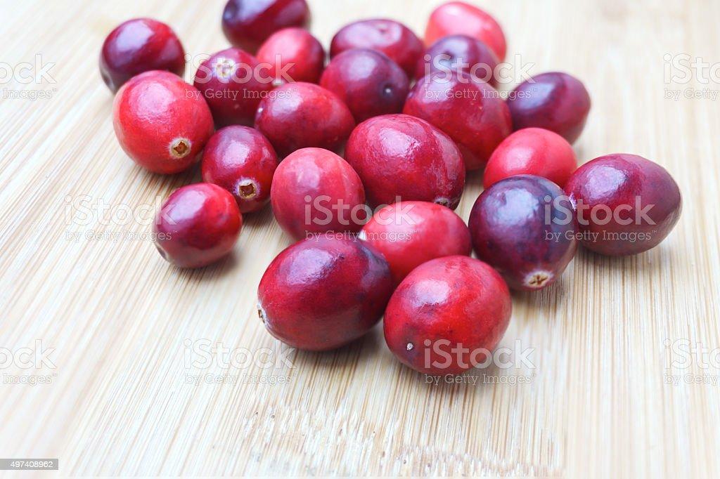 Fresh Cranberries on wood background stock photo