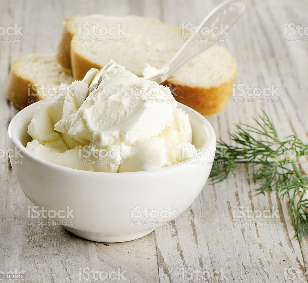fresh cream cheese with herbs stock photo