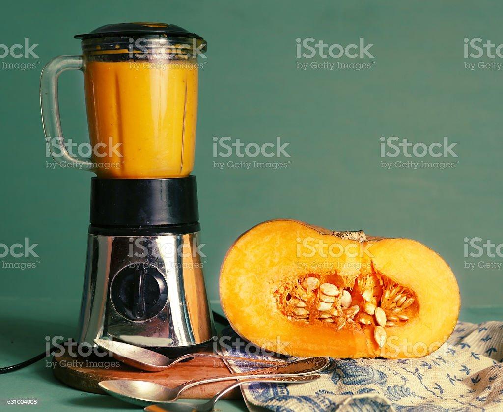 fresh  cream soup in mixer and cut pumpkin stock photo