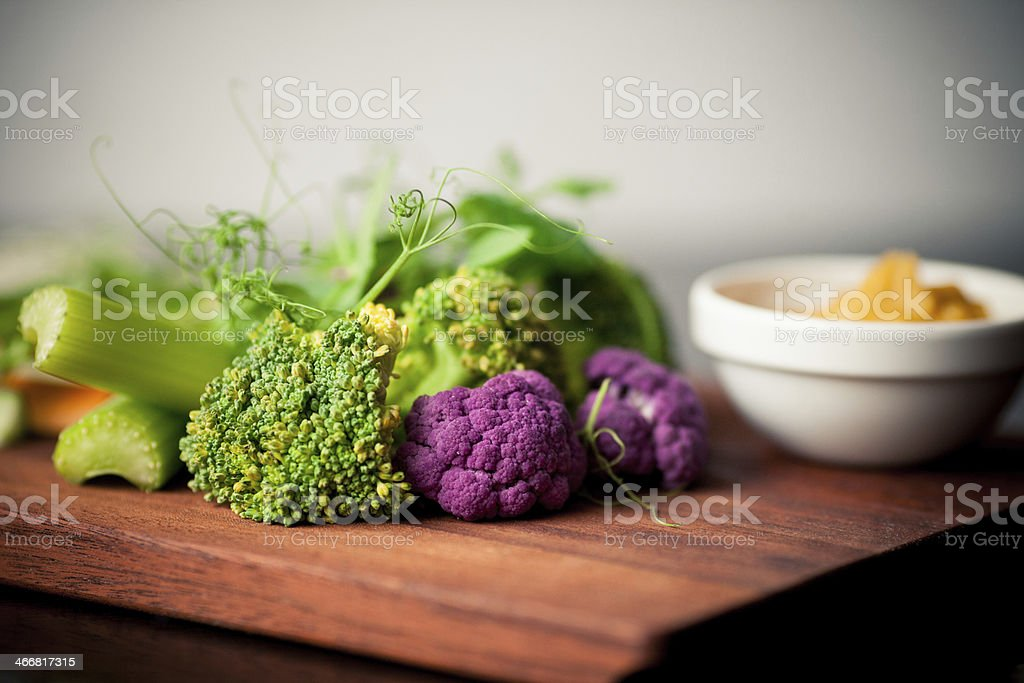 Fresh, crisp, vegetables on a dark wood cutting board stock photo