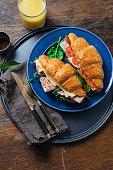 Fresh croissant sandwiches orange juice wooden table