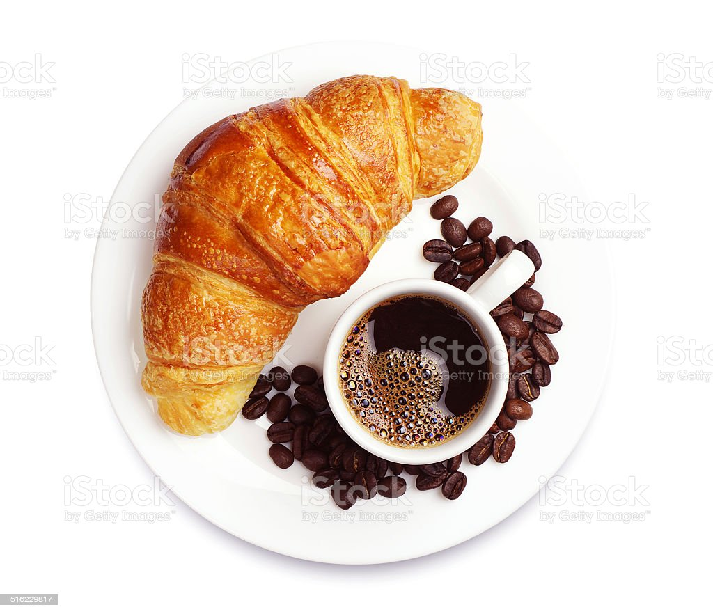 Fresh croissant with coffee stock photo