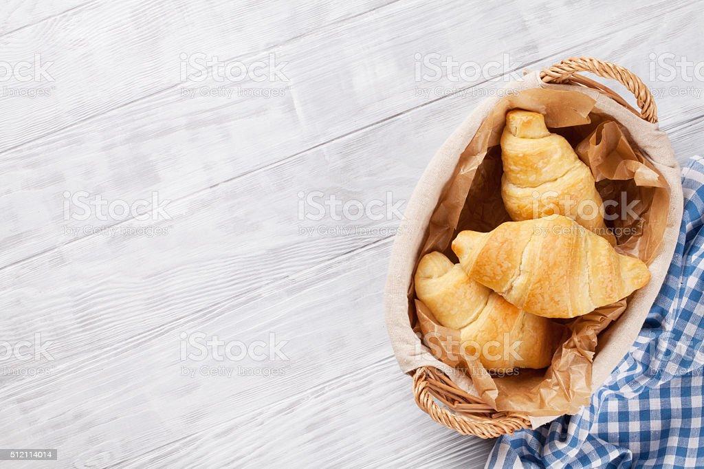 Fresh croissants basket stock photo