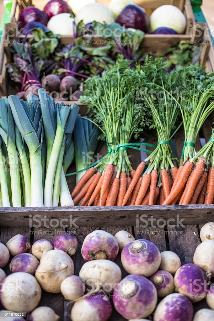Fresh crop of picked Vegetables in a rustic cart. stock photo