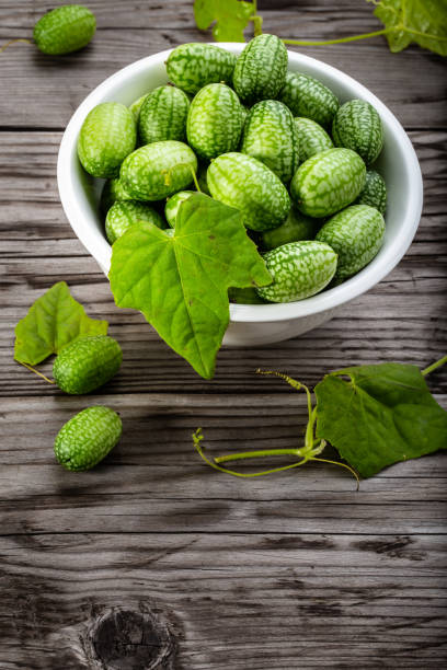 Cтоковое фото Fresh cucamelons on table