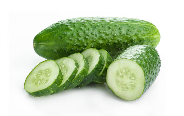 fresh cucumber, chopped cucumber with pieces, isolated on white. - cucumber stock photos and pictures