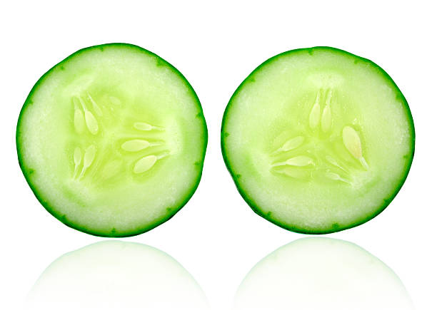 fresh cucumber slice isolated on white background - cucumber stock photos and pictures
