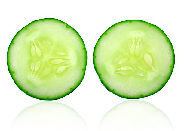 Fresh cucumber slice isolated on white background stock photo