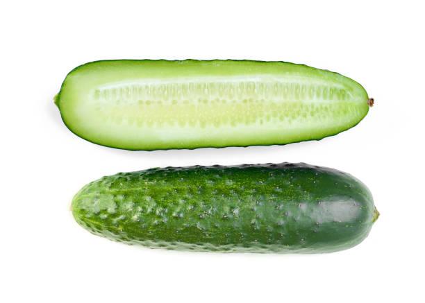 fresh cucumber with half slice isolated on white background stock photo