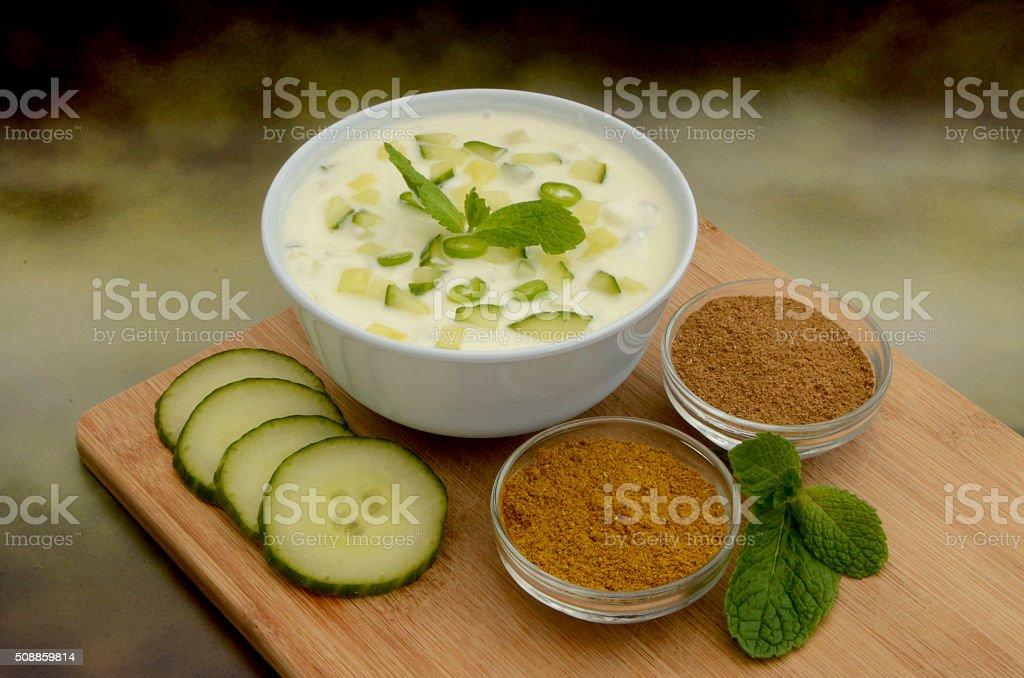 Fresh Cucumber Yoghurt Raita and Ingredients stock photo