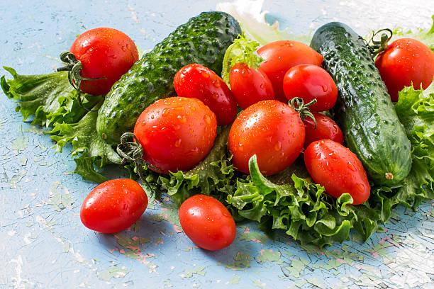 Fresh cucumbers, tomatoes, lettuce stock photo