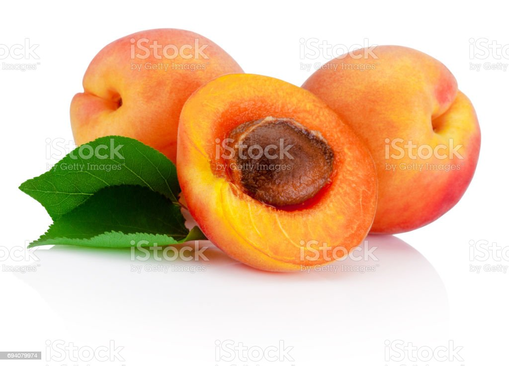Fresh cut apricot fruits with leaf isolated on white background stock photo