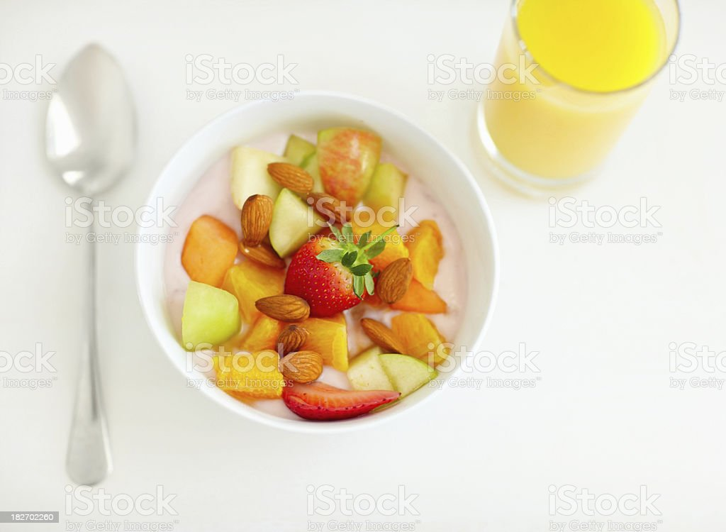 Fresh cut fruits served with a glass of juice royalty-free stock photo
