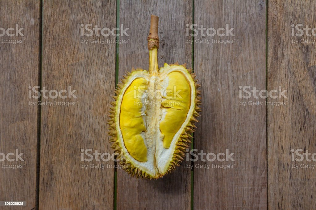 Fresh Cut Kanyao Durian on wooden background stock photo