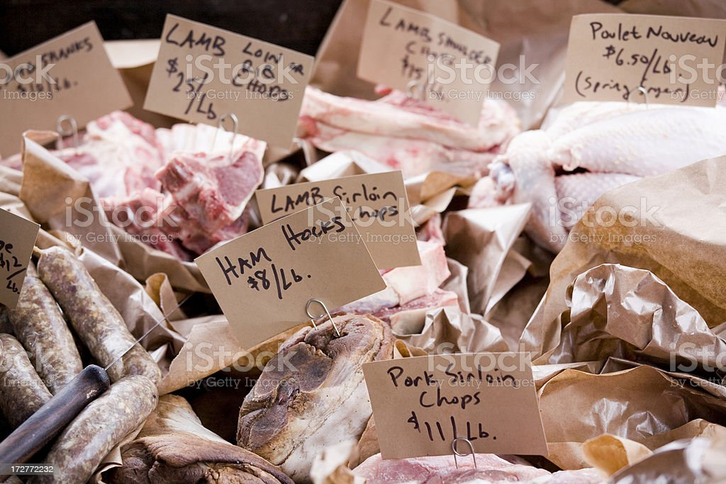 Fresh cut meats at an outdoor farmers market royalty-free stock photo