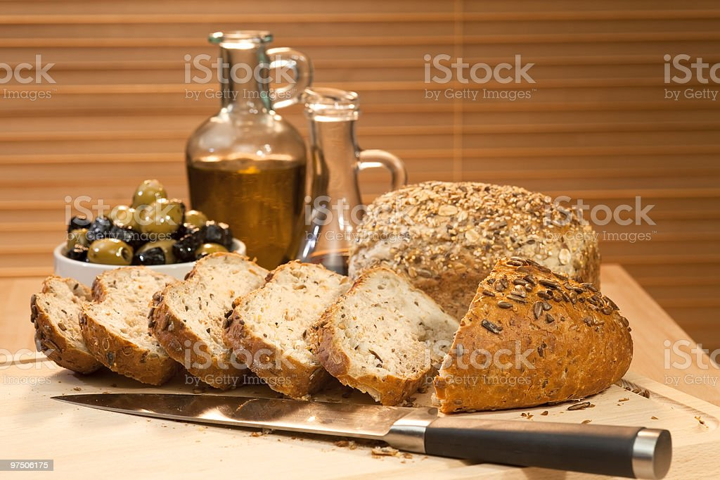 Fresh Cut Rustic Bread, Olive Oil & Green and Black Olives royalty-free stock photo