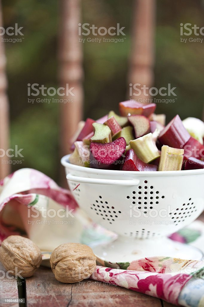 Fresh cut up rhubarb in white colander royalty-free stock photo
