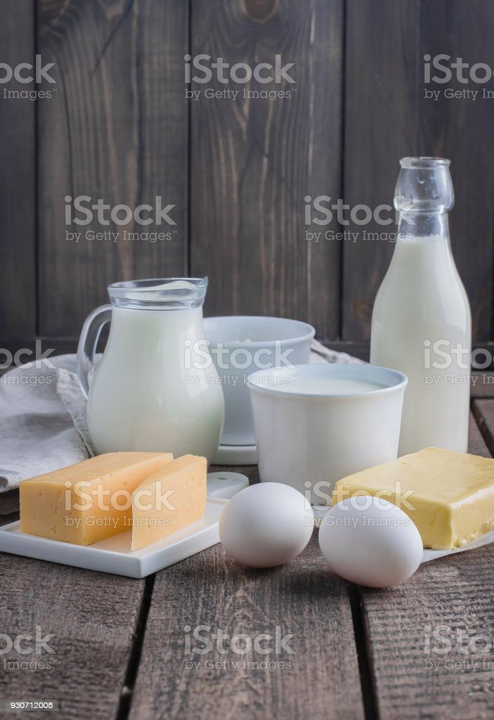 Fresh dairy product on kitchen wooden table. Cheese, eggs, milk, cottage  cheese