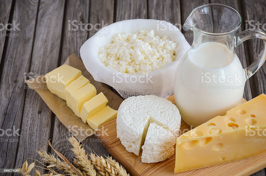 Fresh dairy products - milk, cheese, butter and cottage cheese stock photo