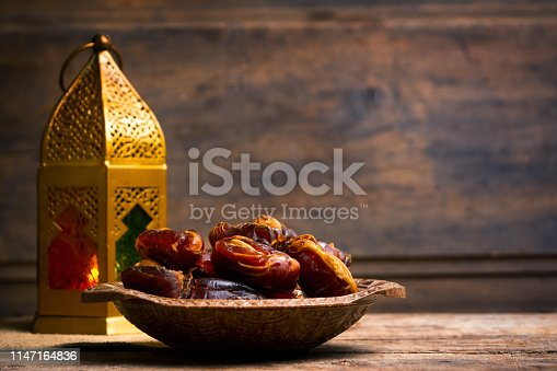 istock Fresh dates with almonds on a table 1147164836