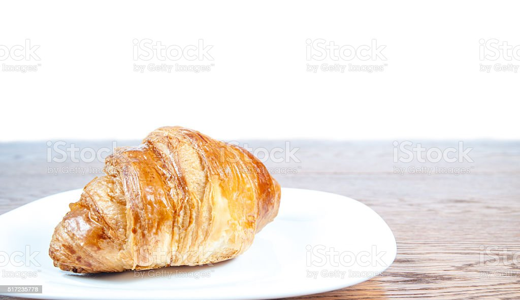 fresh delicious croissant lying on a table stock photo