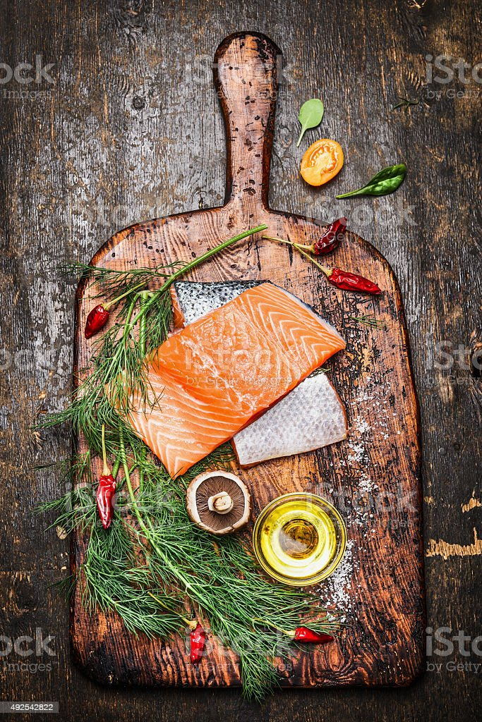 Fresh delicious salmon fillet with ingredients for cooking stock photo