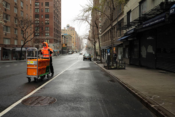 nyc fresh direct delivery man walks down empty lexington avenue - essential workers stock pictures, royalty-free photos & images