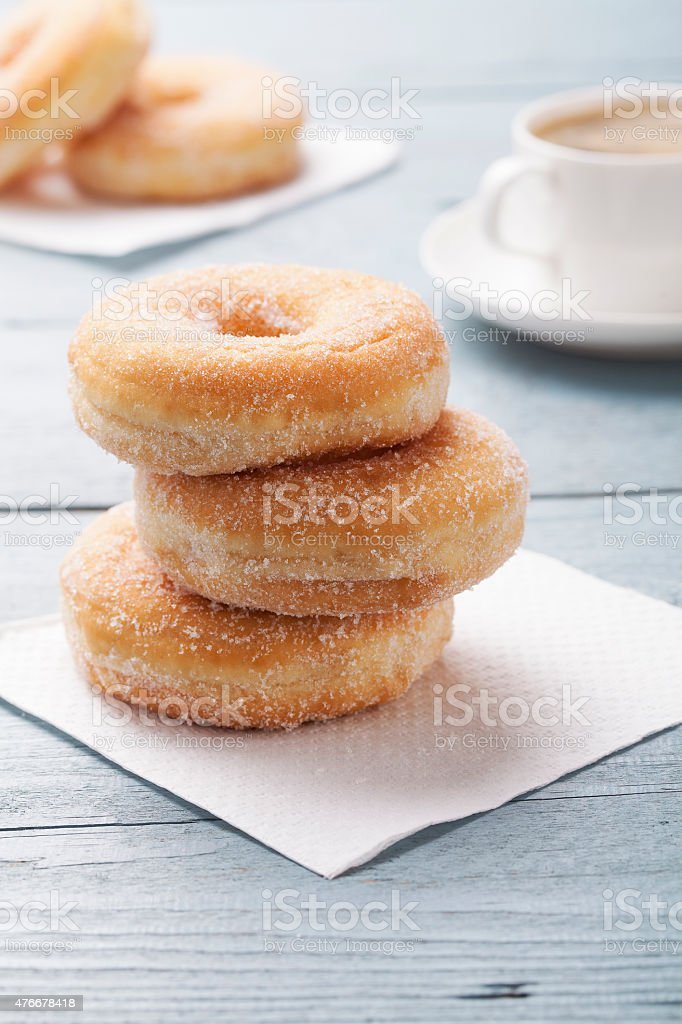 Fresh donut served with a cup of coffee stock photo