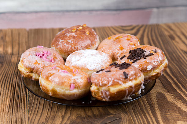 Fresh donuts on wooden table