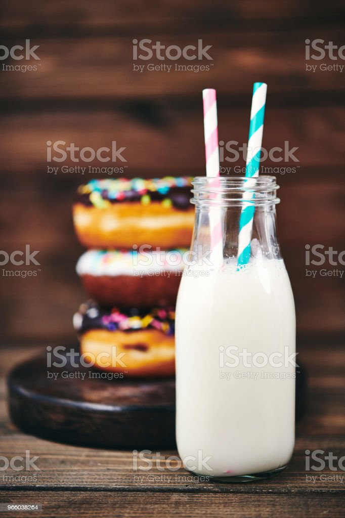 Fresh donuts with ice cold milk in rustic setting - Royalty-free Above Stock Photo