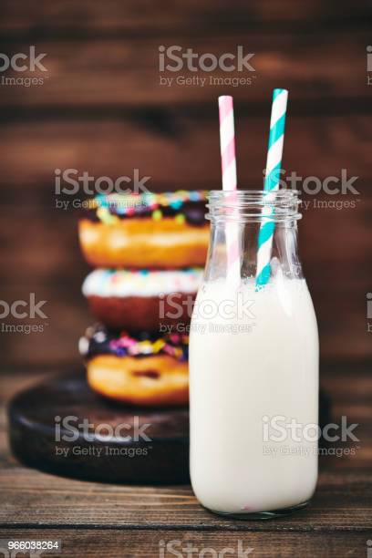 Fresh Donuts With Ice Cold Milk In Rustic Setting Stock Photo - Download Image Now