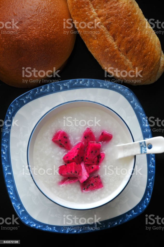 Fresh Dragon fruit Rice-Congee and bread stock photo