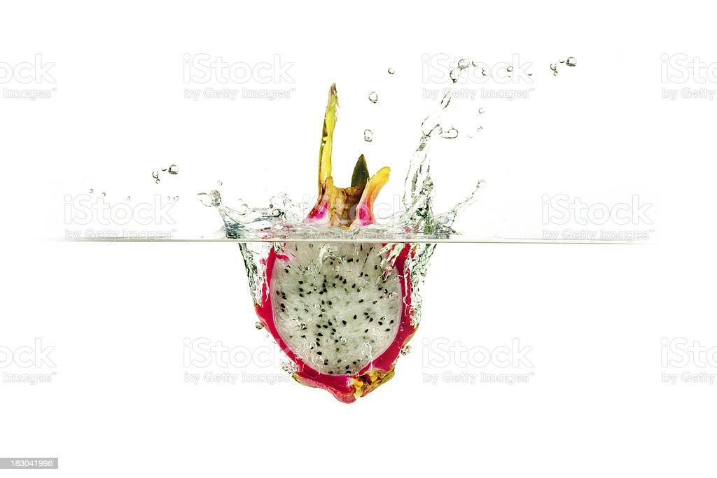 Fresh dragon fruit water splash stock photo