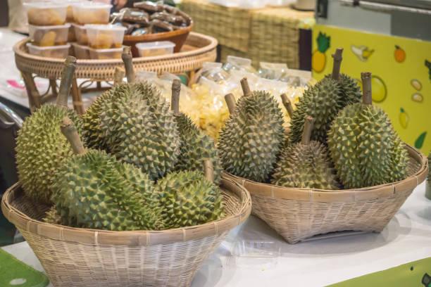 Fresh Durian Fruit in Handcraft Basket Fresh Market Fresh Food Concept stock photo