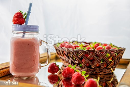 istock Fresh earth yeast milk with fresh strawberries in a basket 1157213698