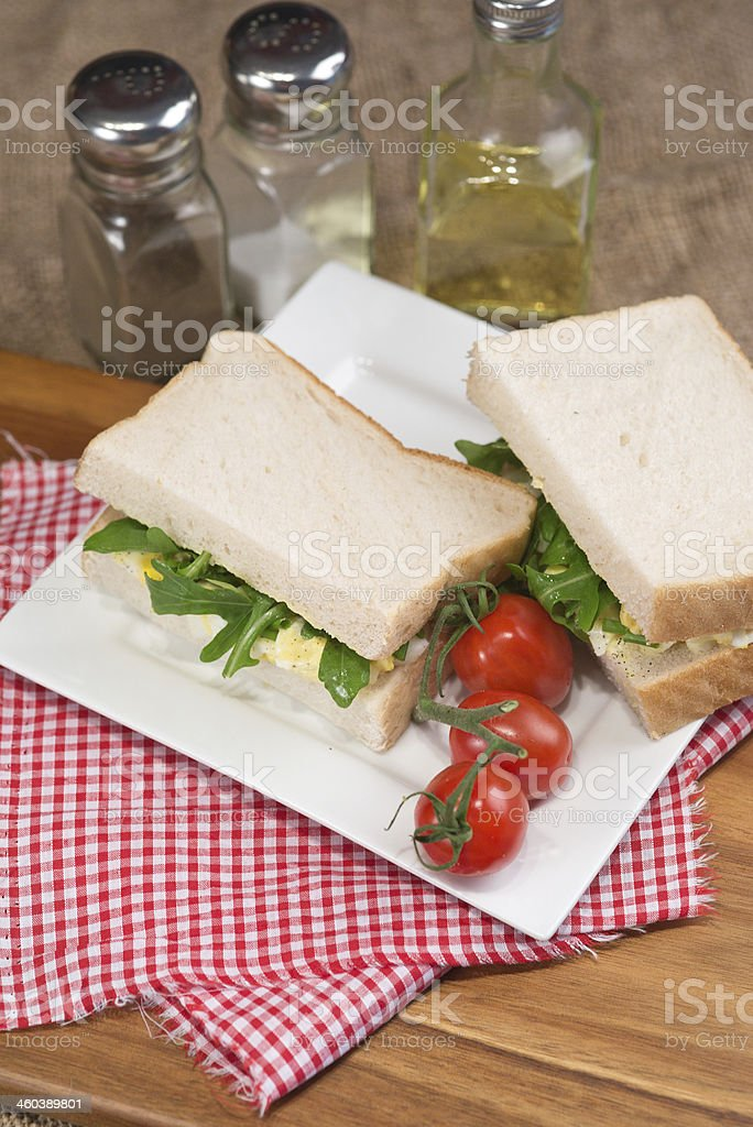 Fresh egg and rocket on white sandwich in kitchen setting royalty-free stock photo