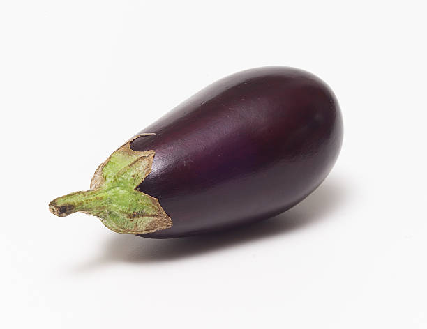 A fresh eggplant with a white background stock photo