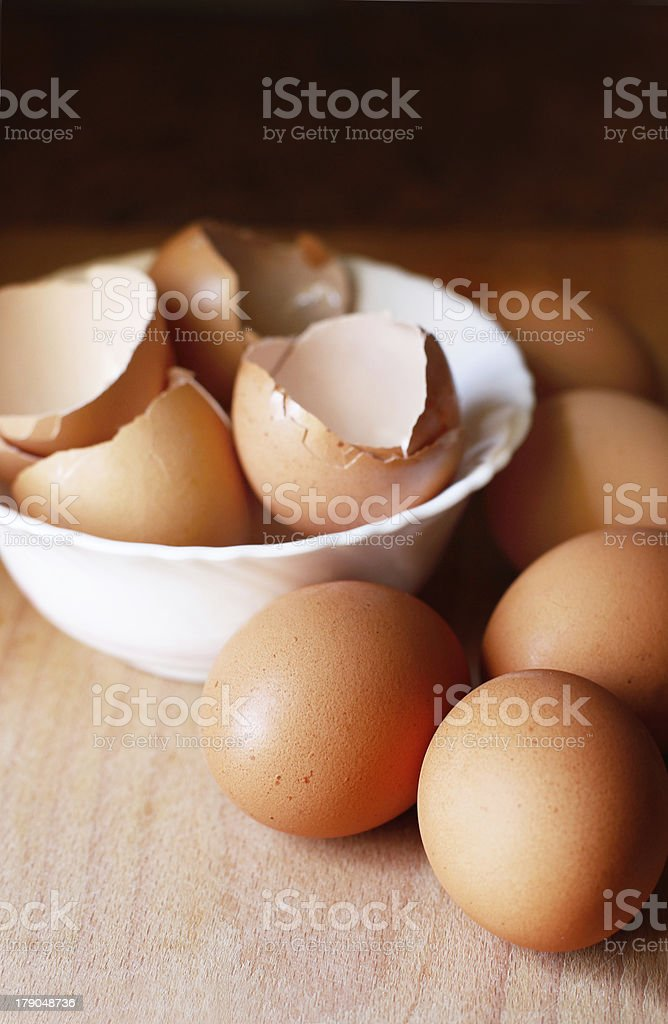 Fresh eggs and empty ones in the bowl royalty-free stock photo