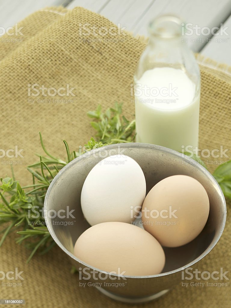 Fresh eggs, herbs and cream on brown burlap royalty-free stock photo
