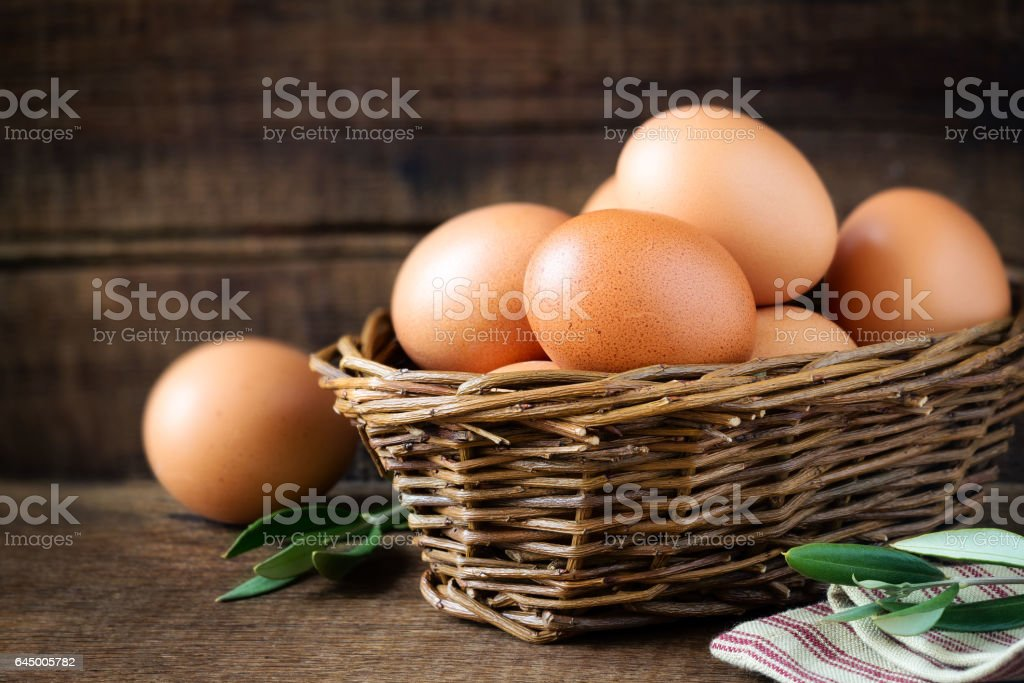 Fresh eggs in a basket stock photo