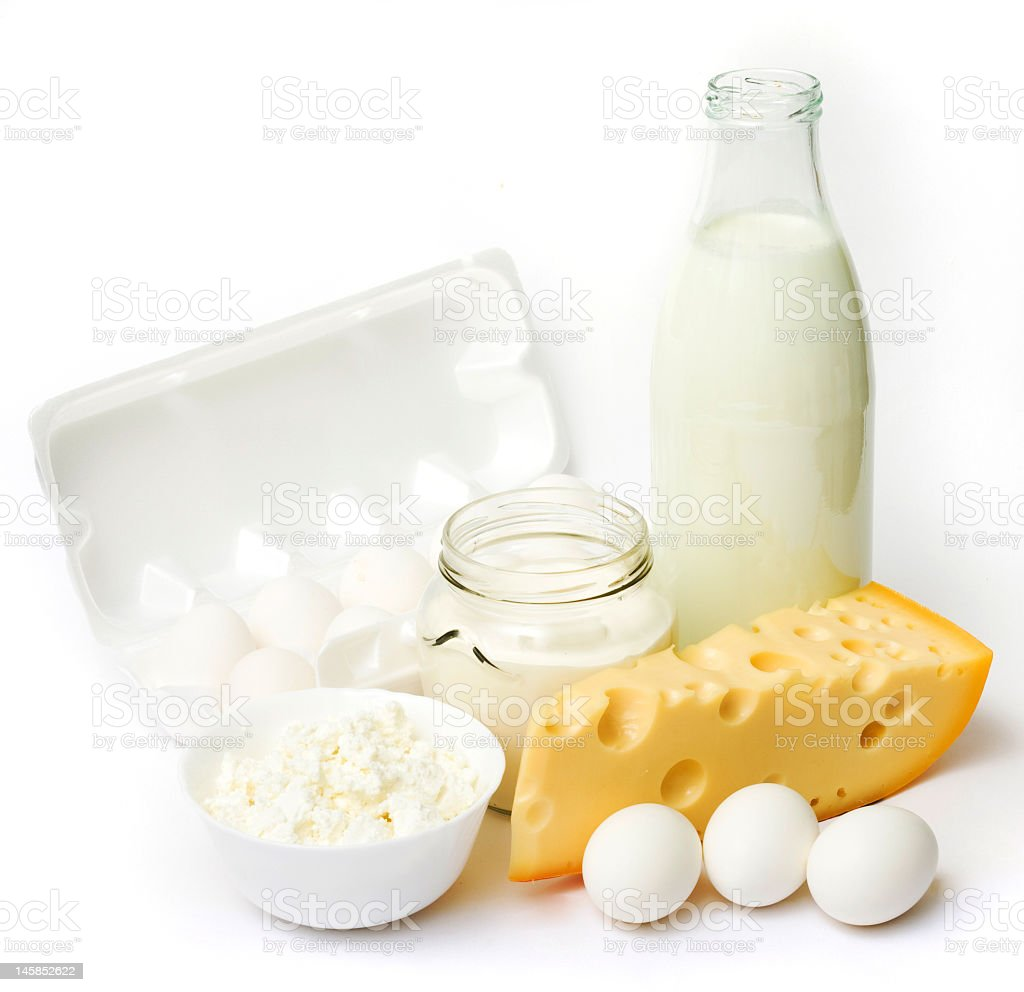Fresh eggs, milk, and cheese on a white background royalty-free stock photo