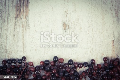 istock Fresh elderberry on old board, copy space for text 1062814842