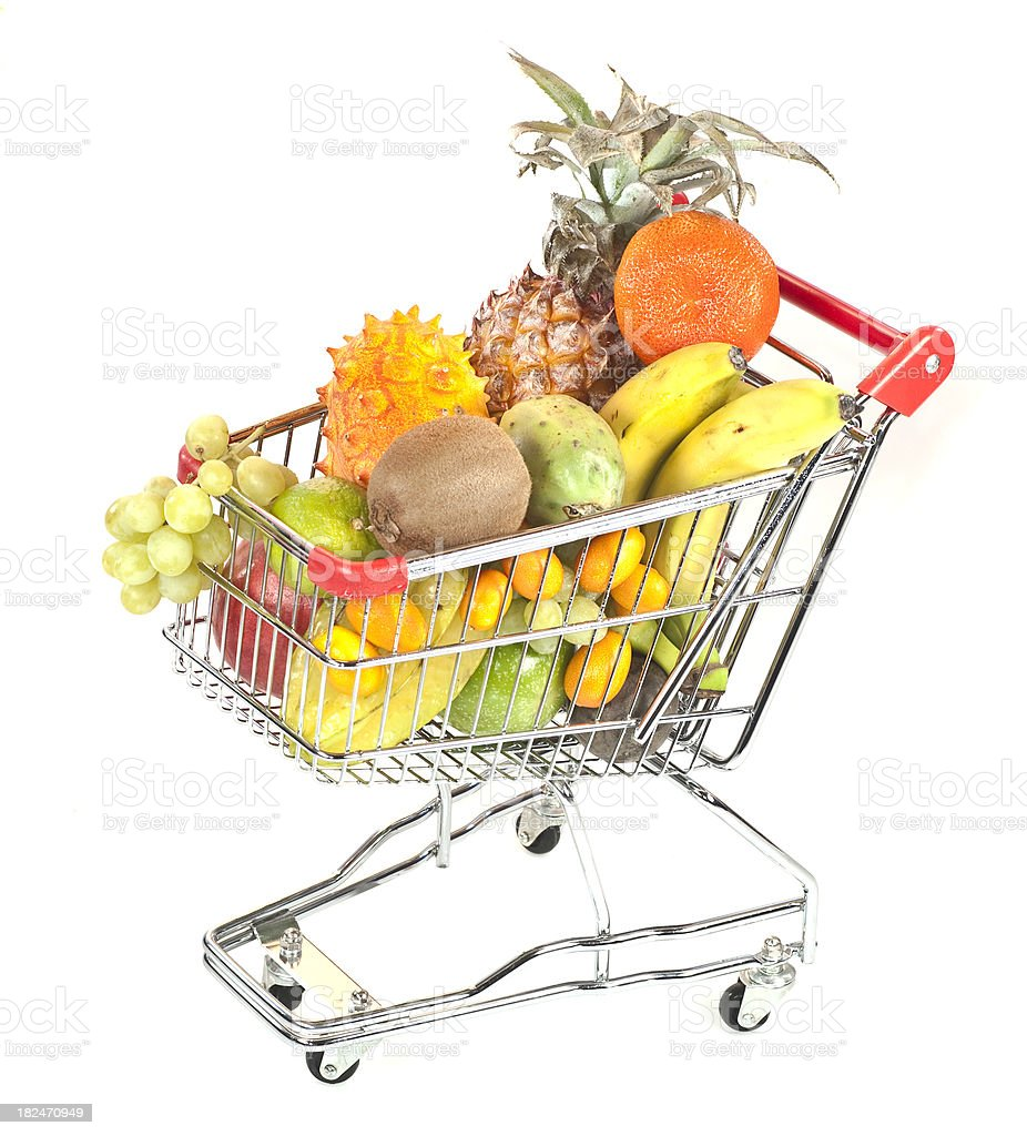 fresh exotic fruits in shopping cart royalty-free stock photo